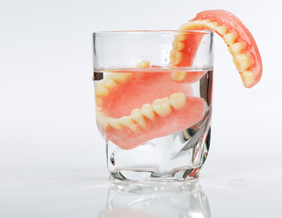 featured image for implants or dentures